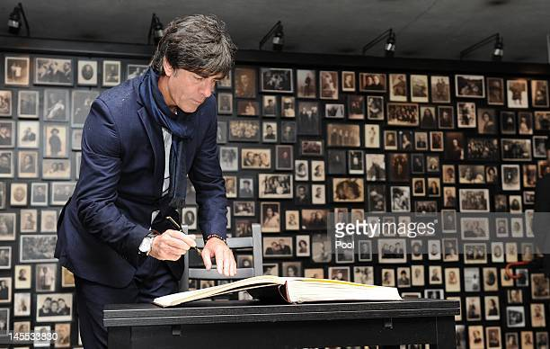 German coach Joachim Loew signs a book of condolence on a book of condolence to the victims of the Nazi regime during a visit by a German Football...