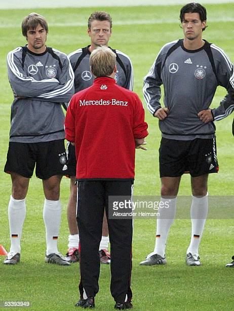 German coach Juergen Klinsmann talks to Sebastian Deisler Christian Woerns and Michael Ballack during the training session of the German National...