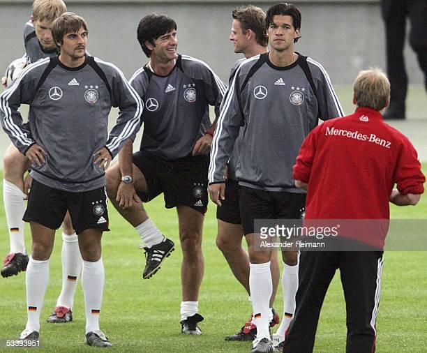 German coach Juergen Klinsmann talks to Sebastian Deisler Joachim Loew Christian Woerns and Michael Ballack during the training session of the German...