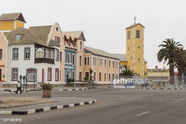 German colonial architechture buildings stand on a street in Swakopmund, Namibia, on April 4, 2019. Located on the coast of Namibia, Swakopmund is...