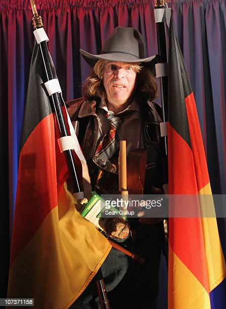 German comedian and entertainer Helge Schneider jokes with the media while presenting his 2011 Buxe Voll tour at Admiralspalast on December 7 2010 in...