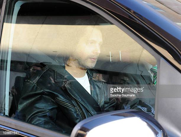 German comedian Oliver Pocher dressed up as Joerg Kachelmann is pictured in a a car outside the district court on day one of the trial against the tv...
