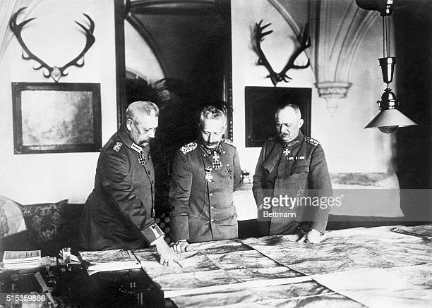 German Command Left to right Paul Von Hindenburg Kaiser Wilhelm II and Erich Ludendorf are shown looking at a map Undated