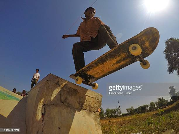 A young boy riding on a skateboard at Skating Park popularly known as Janwaar Castle on October 26 2016 in Janwaar India JANWAAR INDIA OCTOBER 26...