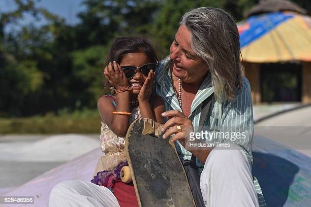 German community activist and author Ulrike Reinhard with village girl at Skating park popularly known as Janwaar Castle on October 26 2016 in...