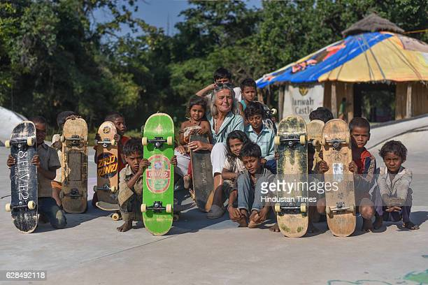 German community activist and author Ulrike Reinhard with village children at Skating Park, popularly known as Janwaar Castle, on October 26, 2016 in...