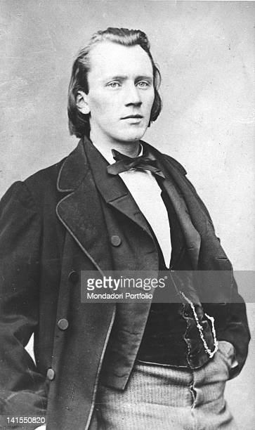 German composer Johannes Brahms wearing a waistcoat and keeping his hand in his pocket 1870s