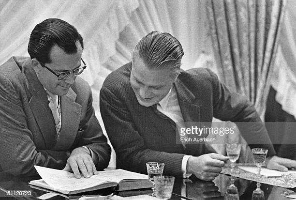 German conductor and pianist Wolfgang Sawallisch and German soprano Eberhard Wachter listening to a recording at Elisabeth Schwarzkopf's Hampstead...