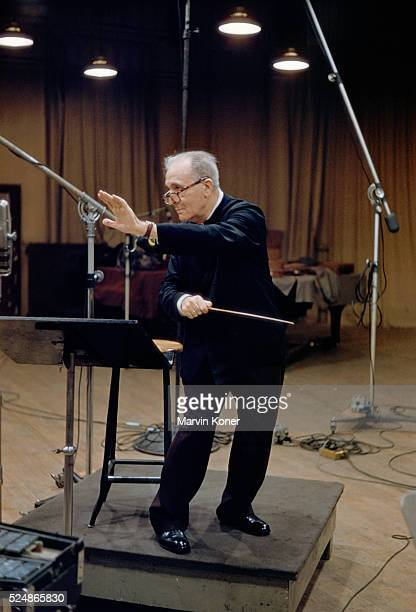 Conductor Bruno Walter conducting an orchestra at a recording studio in 1950