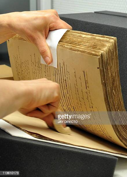 German conservator Monika ScheneiderGast works to restore the centuryold book titled El Filibusterismo at the National Library in Manila on May 4...