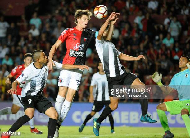 German Conti of Argentina's Colon heads to score against Venezuela's Zamora during their Copa Sudamericana football match at the Brigadier General...