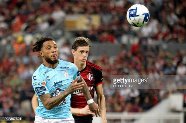 German Conti of Atlas vies for the ball with Colin KazimRichards of Pachuca during the Mexican Clausura 2020 tournament football match at Jalisco...