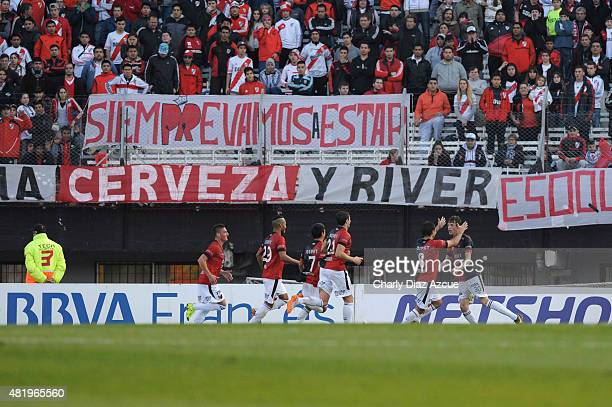 German Conti of Colon celebrates with teammates after scoring the opening goal during a match between River Plate and Colon de Santa Fe as part of...
