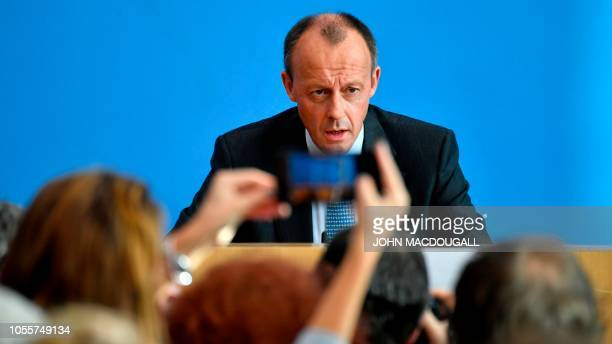 German corporate lawyer and former parliamentary group leader of the Christian Democratic Union , Friedrich Merz speaks during a press conference on...