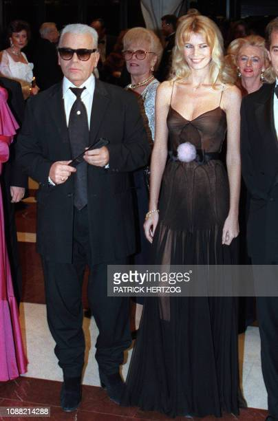 German couturier Karl Lagerfeld of Chanel Fashion House and German top model Claudia Schiffer arrive at the Sporting Club of Monaco late April 2 1995...