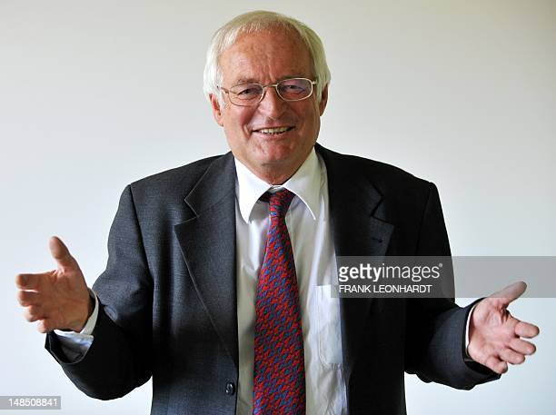 German criminal judge Joachim Eckert gestures at his office at the higher regional court in Munich southern Germany on July 18 2012 Eckert will head...