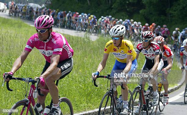 German cyclist Jan Ullrich pedals next to yellow jersey Australian Michael Rogers during the seventh stage of the 69th Tour de Suisse cycling race...