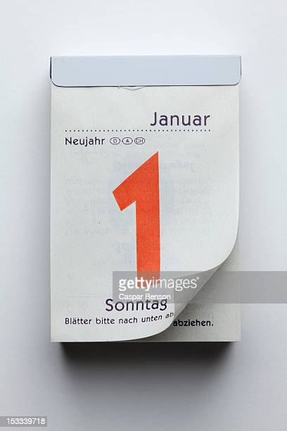 a german daily calendar showing new year's day with curled up page corner - dia de ano novo imagens e fotografias de stock