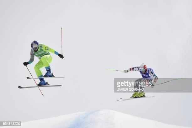 German Daniel Bohnacker and Italian Siegmar Klotz compete during the men's SkiCross semi finals at the FIS Snowboard and Freestyle Ski World...