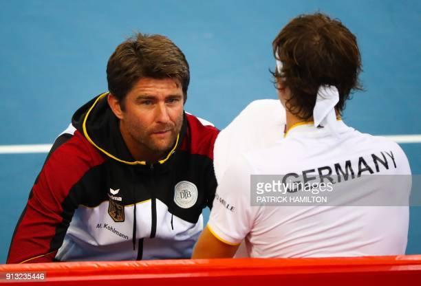 German Davis Cup captain Michael Kohlmann speaks with Alexander Zverev of Germany after a game against Alex De Minaur of Australia during their men's...