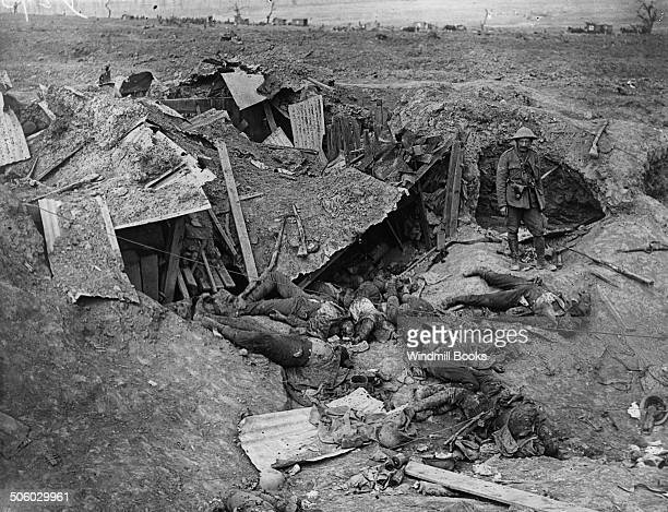 German dead behind a destroyed machinegun post Horse drawn ambulances in the background near Guillemont September 1916 British Front France General...