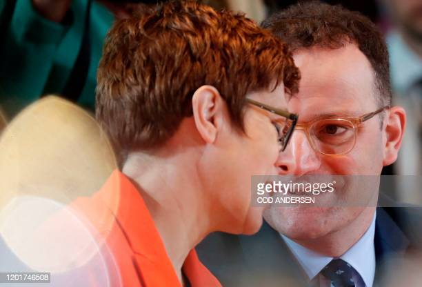 German Defence Minister and leader of the Christian Democratic Union Annegret KrampKarrenbauer and German Health Minister Jens Spahn talk at the...