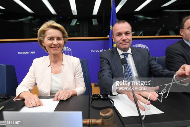 German Defence minister and newly-appointed EU commission chief Ursula von der Leyen and EU Parliament's political group EPP president Manfred Weber...