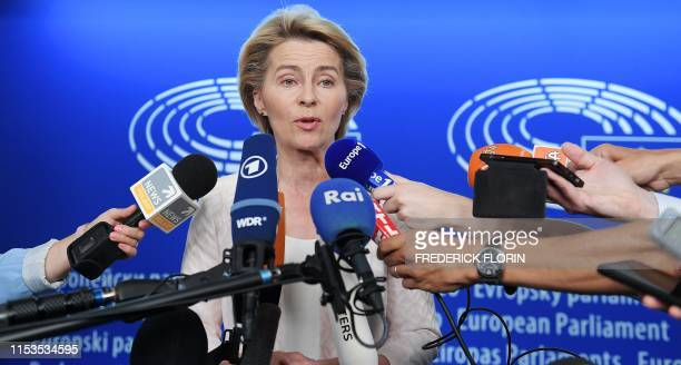 German Defence Minister and newlyappointed EU commission Ursula von der Leyen smiles as he speaks to journalists during the first plenary session of...