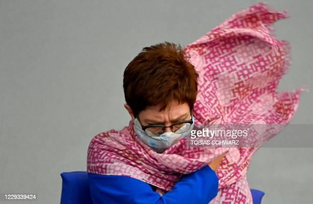 German Defence Minister Annegret Kramp-Karrenbauer adjusts her scarf during a session at the Bundestag on October 29, 2020 in Berlin. - German...