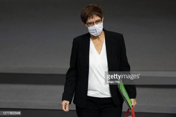 German Defence Minister Annegret KrampKarrenbauer wears a face mask as she arrives in the Bundestag on September 29 2020 in Reichstag building in...