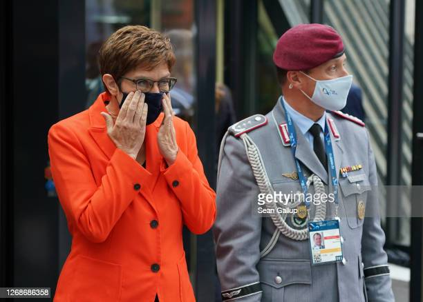 German Defence Minister AnnegretKramp Karrenbauer adjusts her protective face mask while waiting for Josep Borell High Representative of the European...