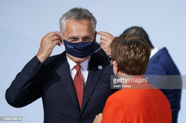 German Defence Minister AnnegretKramp Karrenbauer and NATO Secretary General Jens Stoltenberg put their protective face masks back on following a...