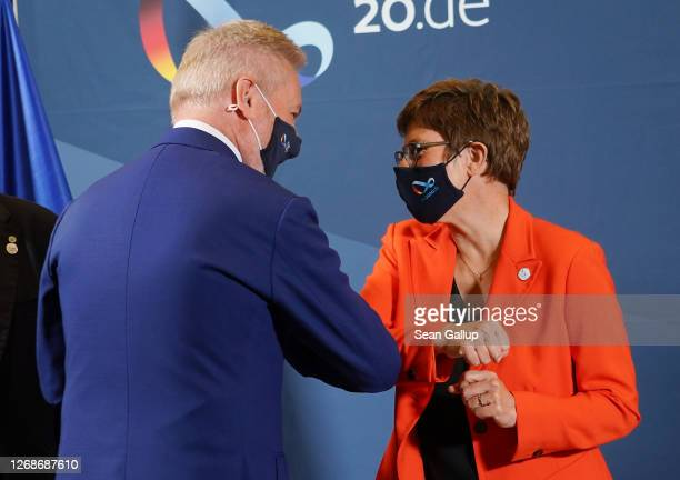 German Defence Minister AnnegretKramp Karrenbauer greets Italian Defence Minister Lorenzo Guerini with her elbow prior to a meeting of European Union...