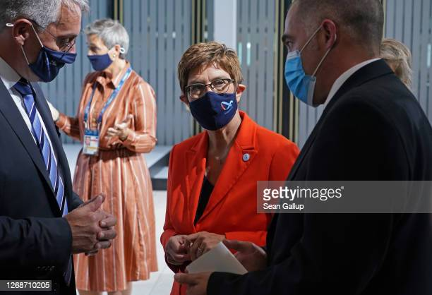 German Defence Minister AnnegretKramp Karrenbauer speaks with participants at a meeting of European Union member states defence ministers on August...