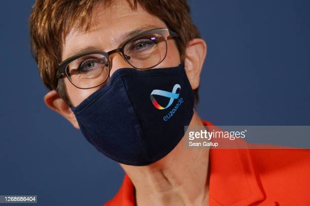 German Defence Minister AnnegretKramp Karrenbauer wears a protective face mask at a meeting of European Union member states defence ministers on...