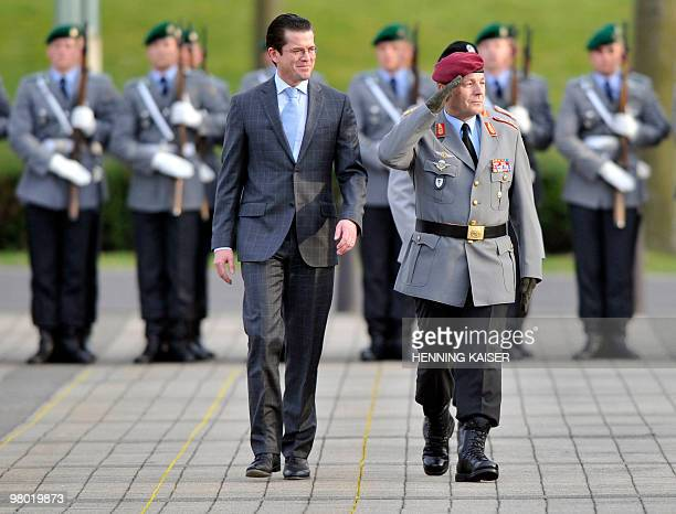 German Defence Minister KarlTheodor zu Guttenberg and Chief of German Army Lt Gen and parting army inspector Hans Otto Budde walk past the soldiers...