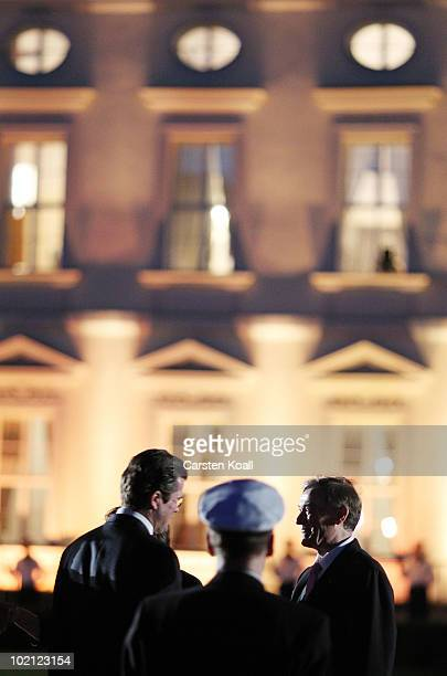 German Defence Minister Karl-Theodor zu Guttenberg , speaks with outgoing German President Host Koehler at the military procession at the Bellevue...