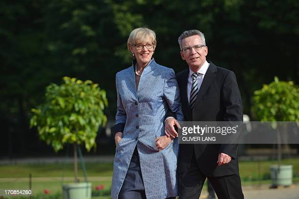German Defence Minister Thomas de Maiziere and his wife Martina de Maiziere pose upon arrival for a state dinner for the US president in Berlin on...