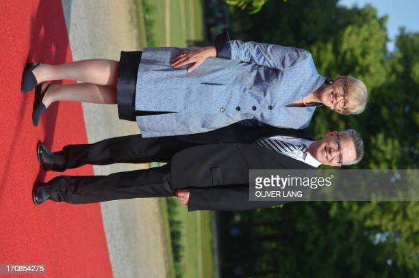 German Defence Minister, Thomas de Maiziere and his wife Martina de Maiziere pose upon arrival for a state dinner for the US president in Berlin, on...