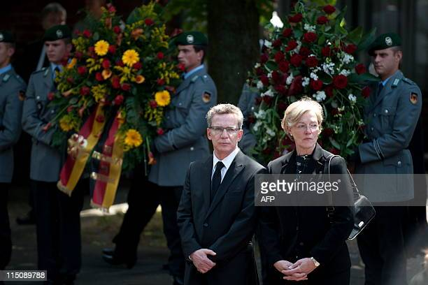 German Defence Minister Thomas de Maiziere and his wife Martina attend the memorial service for three German soldiers killed in Afghanistan at the...