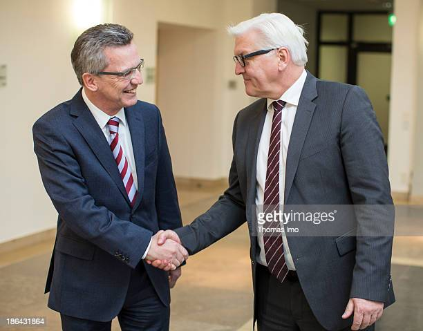 German Defence Minister Thomas de Maiziere from the German Christian Democratic Union and FrankWalter Steinmeier head of the Bundestag faction of the...