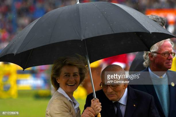 German Defence Minister Ursula von der Leyen and former German rider HansGuenther Winkler attend the prize giving ceremony of the jumping competition...