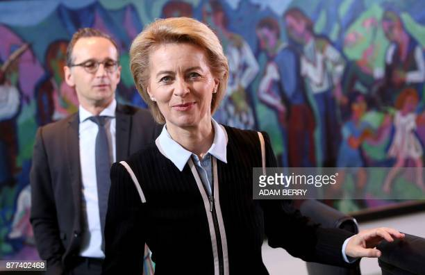 German Defence Minister Ursula von der Leyen and German Justice Minister Heiko Maas arrive for the weekly cabinet meeting in Berlin on November 22...