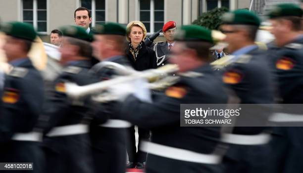 German Defence Minister Ursula von der Leyen and her Georgian counterpart Irakli Alasania watch an army band during a welcome ceremony at the defence...
