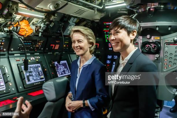 German Defence Minister Ursula von der Leyen and her Norwegian counterpart Ine Marie Eriksen Soreide stand inside the operations room of German...