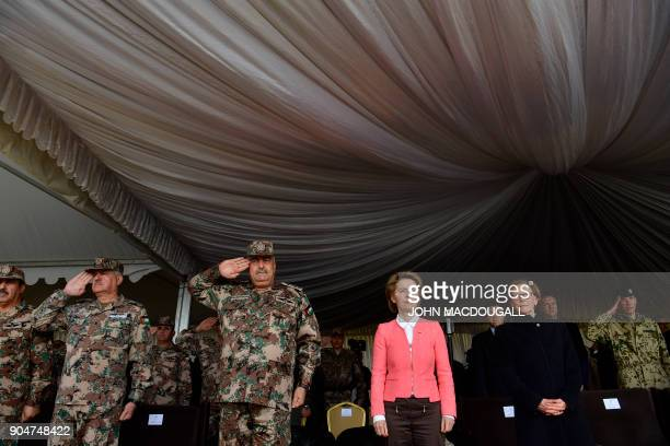German Defence Minister Ursula von der Leyen and Jordanian Chairman of the Joints Chief of Staff Mahmoud Freihat listen to their national anthems...