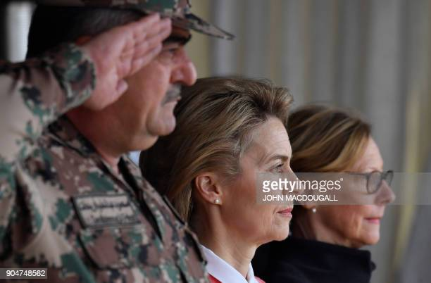 German Defence Minister Ursula von der Leyen and Jordanian Chairman of the Joints Chief of Staff Mahmoud Freihat listen to the national anthems...