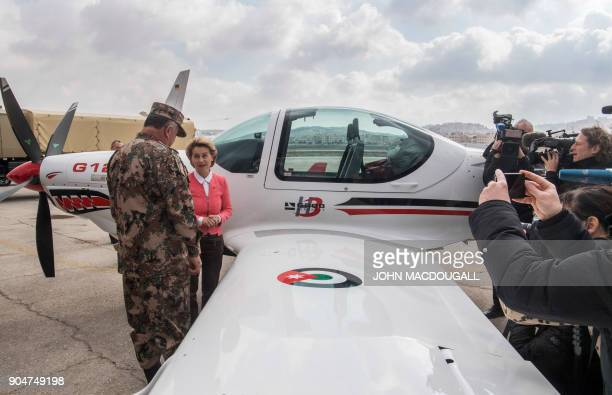 German Defence Minister Ursula von der Leyen and Jordanian Chairman of the Joints Chief of Staff Mahmoud Freihat inspect a GROB G 120TP training...
