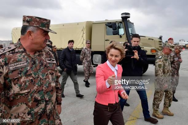 German Defence Minister Ursula von der Leyen and Jordanian Chairman of the Joints Chief of Staff Mahmoud Freihat walk past a MercedesBenz Zetro...