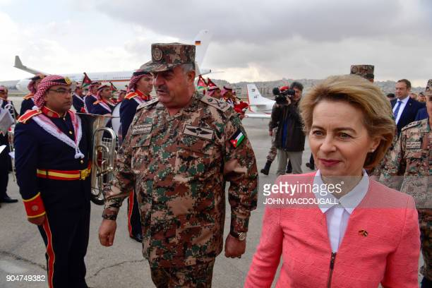 German Defence Minister Ursula von der Leyen and Jordanian Chairman of the Joints Chief of Staff Mahmoud Freihat walk past a Jordanian military band...